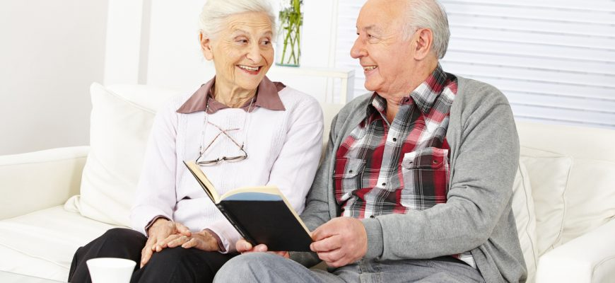 man and woman reading in an assisted living home