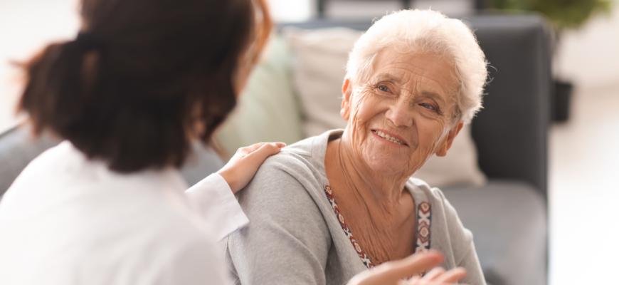 A senior and caregiver at a NY senior care home.